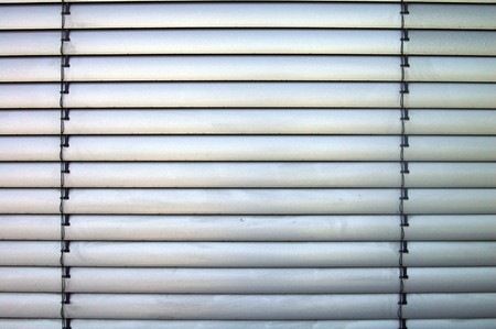 silvery jalousie as thermal protection and blinds Stock Photo