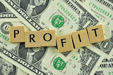 Word profit in lettern on background of dollar banknotes Stock Photo - 10936455