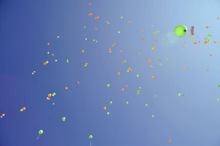 finder: colorful balloons at the sky carrying a message for the finder Stock Photo