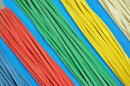 paperboard: colorful rubber bands ordered by colours on a paperboard