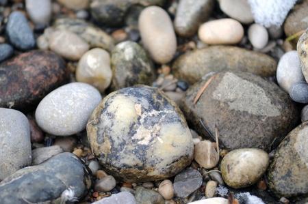 Textured pebbles on a beach Stock Photo