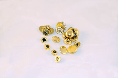 group of different golden buttons photo