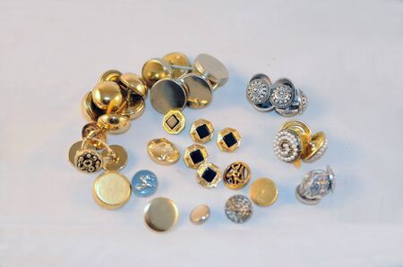 group of different metal buttons
