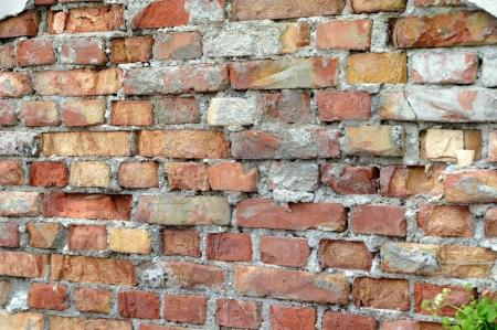 als: old decayed brickwork als background