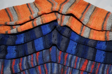 handmade socks of multicolored pure new wool Stock Photo