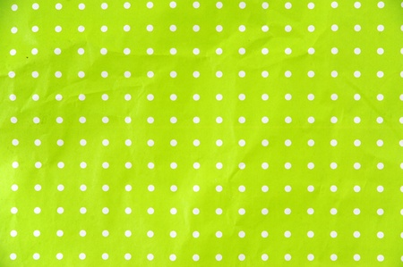 lime green paper with white dots as background photo