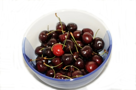 Ripe cherries in a white and blue bowl Stock Photo