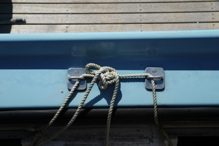 white knot on a blue boat