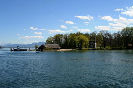 Herreninsel, Lake Chiemsee, Bavaria with chapel Seekapelle zum heiligen Kreuz, boathouse and ferry