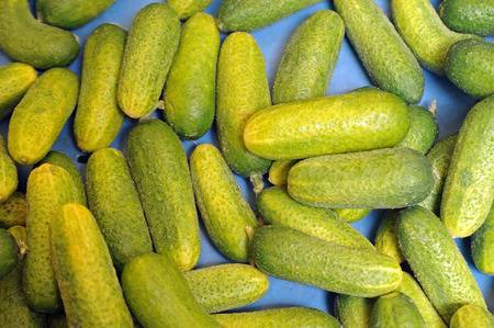 Gherkins in a box at the market Stock Photo
