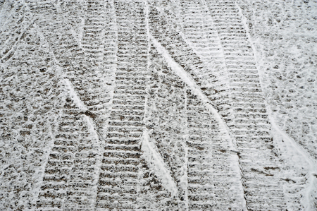 snow covered tracks of a excavator Stock Photo