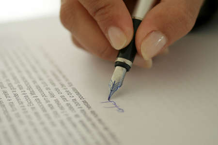 Woman Signing Contract Stock Photo - 690851