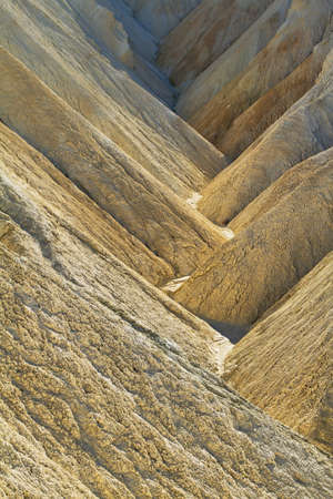 Heavily Eroded Ridges in golden canyon, Death Valley National Park, California, USA photo