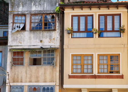 refurbish: Front of old buildings of traditional architecture with large windows  Llanes  Asturias  Spain