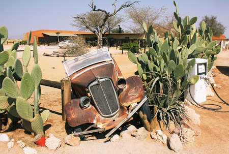 Abandoned old car in Solitaire, Namibia photo
