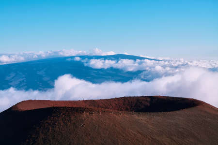 Extinct volcanic crater with Mauna Loa in background from Mauna Kea summit