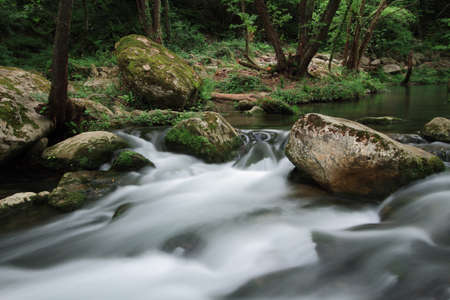 Silky river flow near waterfall known as Santa Margarida, Planes dHostoles, Catalonia