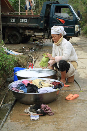 HA GIANG, VIETNAM  - DECEMBER 7  Unidentified woman washing clothes on December 6, 2011 in a village of rural district of Quan Ba