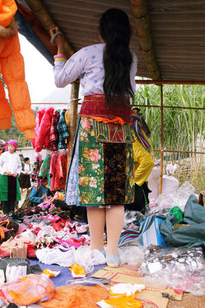 HA GIANG, VIETNAM  - DECEMBER 7  Unidentified people of diferent ethnic groups in Lung Phin market  Lung Phing market is one of the most typical hill tribe markets in Vietnam