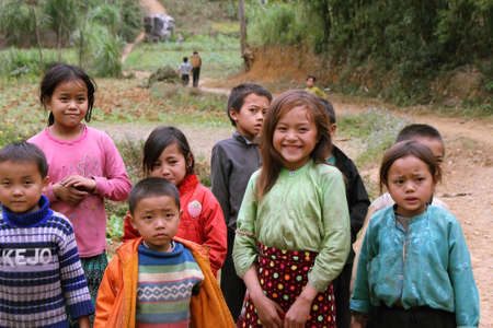 HA GIANG, VIETNAM  - DECEMBER 7  Unidentified kids  on December 7, 2011 in mountainous district of Dong Van  Dong Van is the northernmost district of Vietnam and bordering with China  Editorial