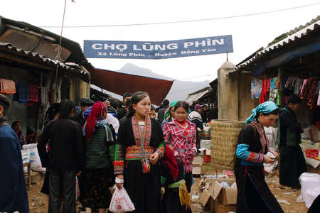 HA GIANG, VIETNAM  - DECEMBER 7  Unidentified people of diferent ethnic groups in Lung Phin market  Lung Phin market is one of the most typical hill tribe markets in Vietnam