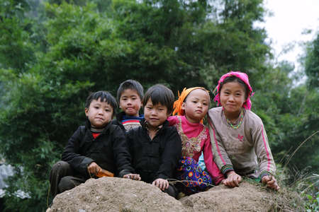 HA GIANG, VIETNAM  - DECEMBER 7  Unidentified kids on December 7, 2011 in mountainous district of Dong Van  Dong Van is the northernmost district of Vietnam and bordering with China