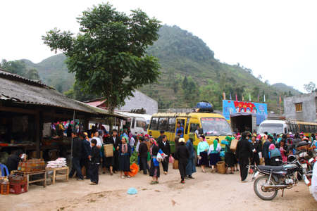 HA GIANG, VIETNAM  - DECEMBER 7: Unidentified people of different ethnic groups in the entrance of Lung Phin market. Lung Phin market is one of the most typical hill tribe markets in Vietnam.