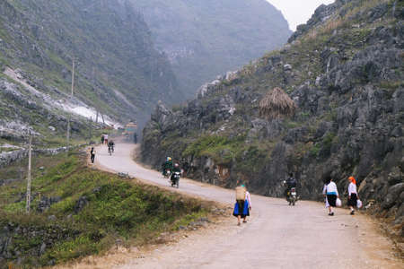 HA GIANG, VIETNAM  - DECEMBER 7: Unidentified people of different ethnic groups leaving  Lung Phin market. Lung Phin market is one of the most typical hill tribe markets in Vietnam.