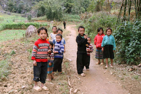 HA GIANG, VIETNAM  - DECEMBER 7: Unidentified kids  on December 7, 2011 in mountainous district of Dong Van. Dong Van is the northernmost district of Vietnam and bordering with China.