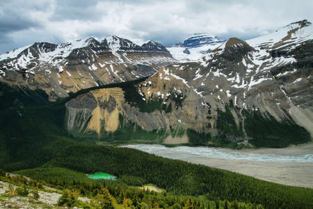 View down Parker Ridge small lakes and mountain range in the Canadian Rockies photo