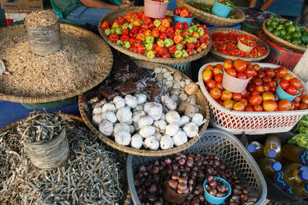 Fresh vegetables and dry fish at a market in Rantepao, Indonesia photo