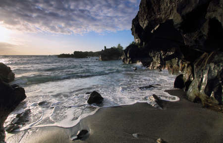 Black sand beach in Waianapanapa State park, Maui island, Hawaii, USA