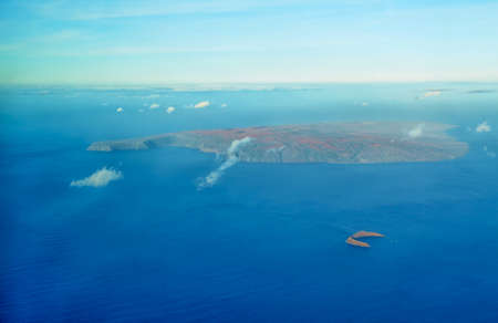 Aerial view of Molokini and Kahoolawe island flying from Maui to Big Island, Hawaii