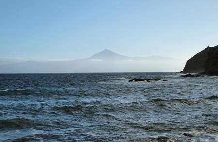 View of Tenerife island from La Caleta beach, La Gomera island, Canary islands, Spain photo
