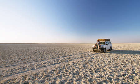 africa baobab tree: Car in the middle of salt lake near Kubu island in winter, Botswana