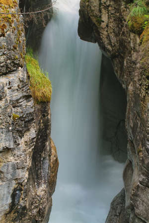 slot canyons: View of one of several Maligne Falls through the narrow Maligne Canyon in Jasper National Park, Alberta, Canada