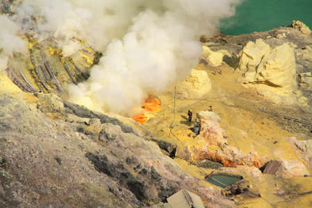 JAVA, INDONESIA-SEPTEMBER 20: Unidentified miners harvest raw sulphur from the crater of Kawah Ijen volcano in hazardous working environment on Sept 20, 2009 in Kawah Ijen, Java island.