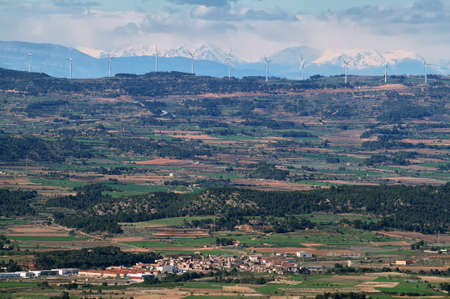 Distant view of pyrenees and windmills from Miramar viewpoint in Tarragona, Spain. photo