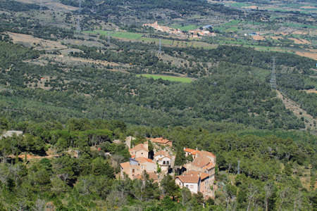 Distant view of Miramar village in the township of Figuerola del Camp, Tarragona, Spain photo