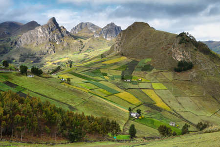 View of colorful terrace fields and scattering farms near Zumbahua village, Ecuador photo