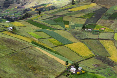 View of colorful terrace fields and scattering farms near Zumbahua village, Ecuador Standard-Bild