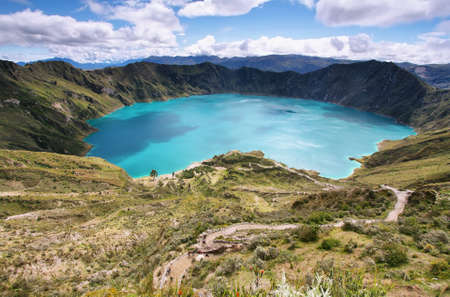 Amazing view of  lake of the Quilotoa caldera. Quilotoa is the western volcano in Andes range and is located in andean region of Ecuador. photo