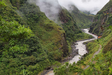 Views of winding Pastaza river and sheer mountains  in route from Banos to Puyo, Ecuador photo