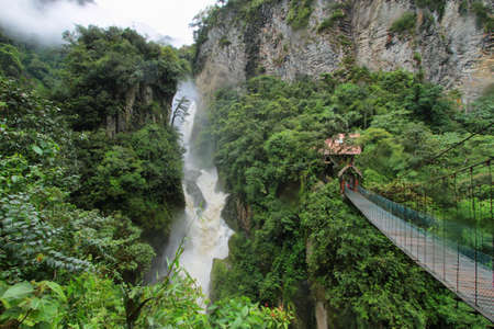 Pailon del Diablo waterfall in a rainy day, Ecuador photo