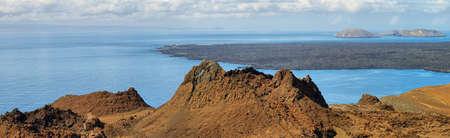 bartolome: Volcanic landscape in Bartolome island and Santiago island at background, Galapagos, Ecuador