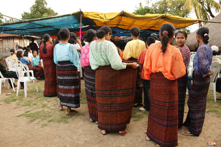 nuptial: FLORES, INDONESIA-SEPTEMBER 21: young girls of minority ethnic group with typical skirts in a nuptial ceremony on September 21, 2009 in Wolowaru, Flores, Indonesia.