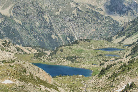 Small glacial lakes in Aiguestortes national park, Spain photo