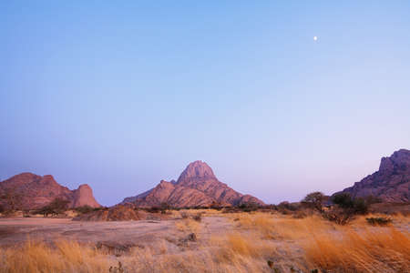 spitzkoppe: Colorful rocky landscape in Spitzkoppe at sunrise, Namibia Stock Photo