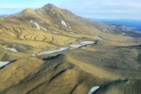 highland region: Aerial view of golden mountains in Iceland Highland region Stock Photo