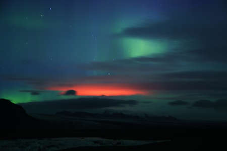 magnetosphere: Aurora borealis or the northern lights and red bardarbunga eruption glowing in Iceland Stock Photo